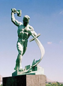 Man beating swords into plowshares